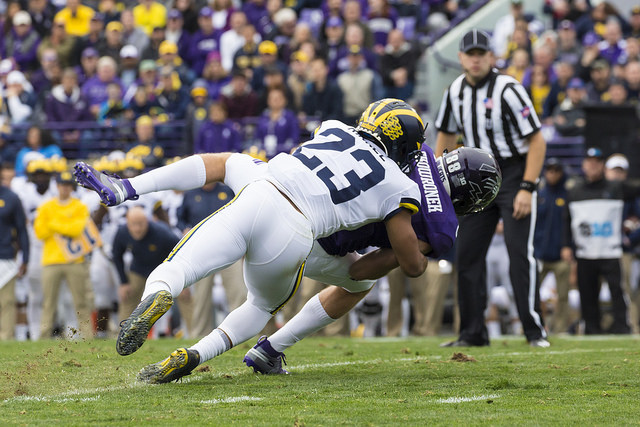 Tyree Kinnel makes a tackle against Northwestern