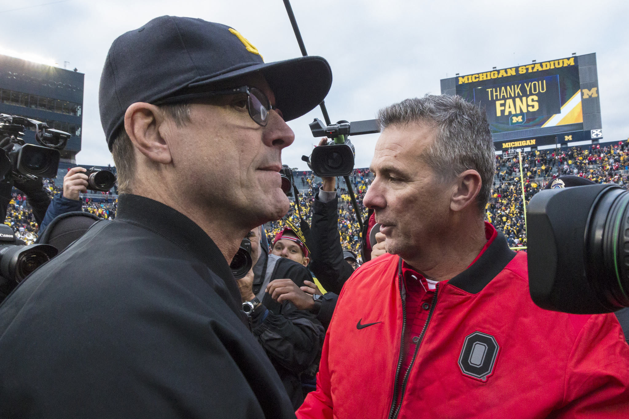 Jim Harbaugh will try and beat Urban Meyer for the first time this Saturday