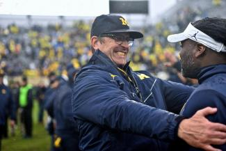 Jim Harbaugh looks excited about, well, something
