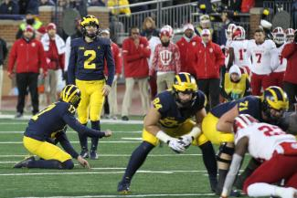 Jake Mood attempts one of his record-breaking six field goal completions against Indiana