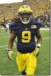 (caption) Michigan wide receiver Martavious Odoms runs to greet the fans after the victory.   *** Michigan finally beat Ohio State 40-34 at Michigan Stadium after seven losses in a row to the Buckeyes, giving head coach Brady Hoke a victory over OSU in his first season as head coach at Michigan. The victory improves Michigan's record to 10-2.  *** Michigan (9-2) tries to avenge seven losses in a row to Ohio State when they host the Buckeyes (6-5) at Michigan Stadium in Ann Arbor in the annual rivalry game.   Photos taken on Friday, November 25, 2011. ( John T. Greilick / The Detroit News )