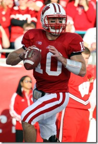 NNov 17, 2012; Madison, WI, USA; Wisconsin Badgers quarterback Curt Phillips (10) looks for a receiver as his team plays the Ohio State Buckeyes during the first half at Camp Randall Stadium.  Mandatory Credit: Mary Langenfeld-US PRESSWIRE