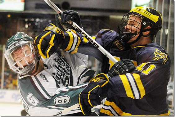 Michigan forward Kevin Lynch (#11) plays against Michigan State in the CCHA tournament on Saturday, March 13, 2010 at Munn Ice Arena in East Lansing.  The Wolverines won 5-3. (ARIEL BOND/Daily)