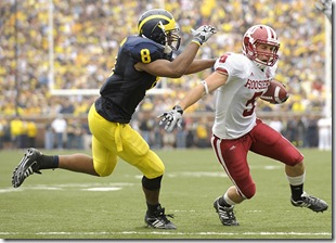 (CAPTION INFORMATION)<br /> Indiana's Mitchell Evans is chased down by Michigan's Jonas Mouton in the second quarter.       Photos are of the University of Michigan vs. Indiana University at Michigan Stadium in Ann Arbor, September 26, 2009.  (The Detroit News / David Guralnick)
