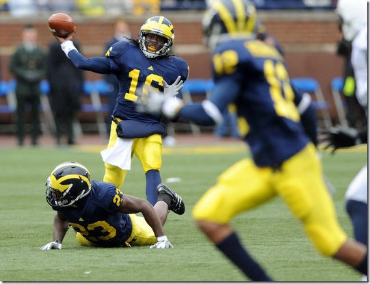 Michigan quarterback Denard Robinson tries to fire a pass to wide receiver Roy Roundtree, but it was picked off by Penn State's Navorro Bowman, one of four Michigan turnovers that helped the Nittany Lions hand Michigan a 35-10 pasting, Saturday, October 24th at Michigan Stadium.Lon Horwedel | AnnArbor.com