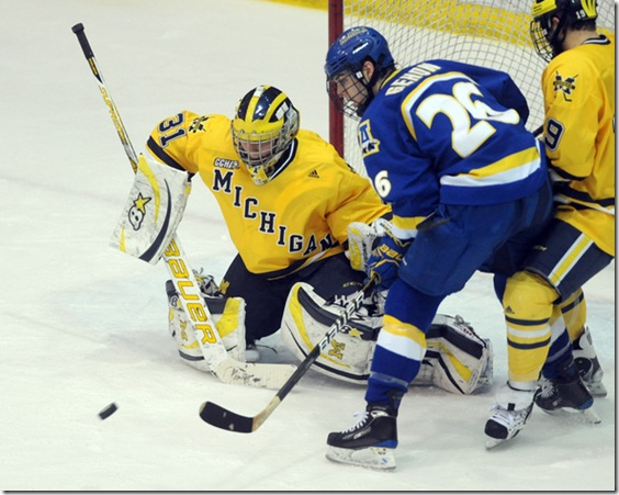 Michigan goalie Shawn Hunwick tries to keep Alaska Fairbank's Chad Gehon, right, from scoring during second period action of Saturday, Janaury 22nd's clash between the two teams at UM's Yost Ice Arena.<br /> Lon Horwedel | AnnArbor.com