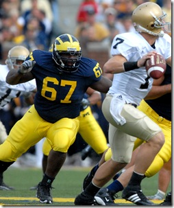 DT Terrance Taylor (67), DT John Ferrara (94), and DE Brandon Graham (65) pressure Irish QB Jimmy Clausen (7) during Michigan's 38-0 win over Notre Dame on Saturday, September 15, 2007 at Michigan Stadium. (RODRIGO GAYA/ Daily).
