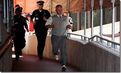 jim-tressel-run-from-cops