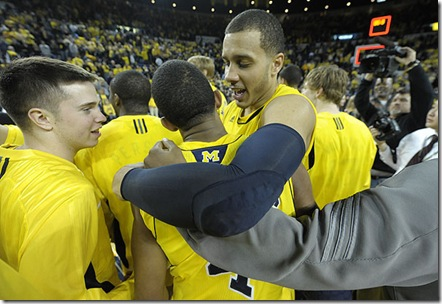 (Mar 5, 2011)  Jordan Morgan hugs Darius Morris after Um beats MSU, 70-63, Saturday afternoon at Crisler Arena in Ann Arbor.  (Dale G. Young/The Detroit News) 2011.