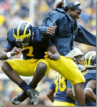 25 September 2010: Quarterbacks Devin Gardner (7) and Denard Robinson (16) of the University of Michigan jump in the air to celebrate a Gardner touchdown as the Wolverines defeat the Bowling Green State University Falcons 65-21 at Michigan Stadium in Ann Arbor, MI.