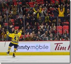 Hughes celebrates