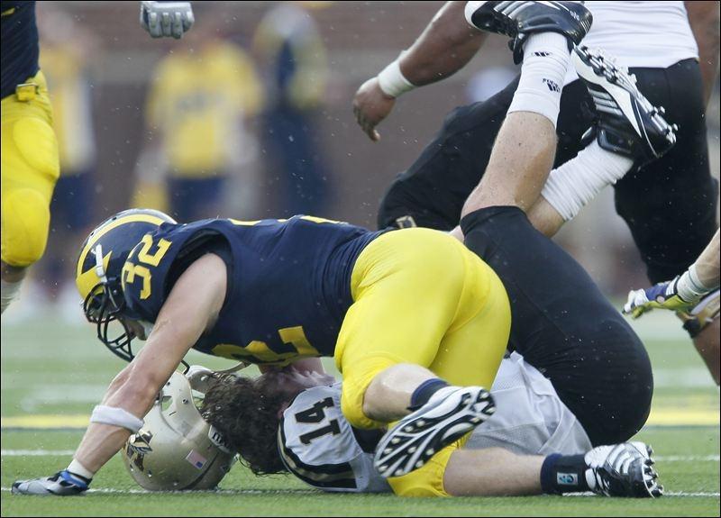 http://mgoblog.com/sites/mgoblog.com/files/Jordan-Kovacs-sacks-Western-Michigan-quarterback-Alex-Carder-in-third-quarter.jpg