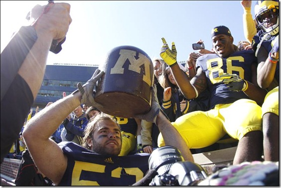 Michigan-s-Ryan-Van-Bergen-holds-up-the-Little-Brown-Jug
