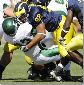 (caption) Michigan defensive tackle Greg Banks (92) clobbers Eastern Michigan running back Dominique Sherrer after a one-yard gain in the fourth quarter. *** Michigan defeated Eastern Michigan 45-17 at Michigan Stadium in Ann Arbor, rushing for 380 yards, but passing for just 68 yards. Photos taken on Saturday, September 19, 2009. ( John T. Greilick / The Detroit News )