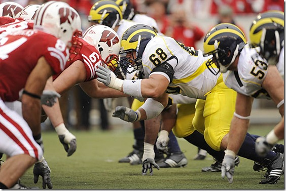 (caption) Wisconsin center Gabe Carimi knocks heads with Michigan defensive tackle Mike Martin across the line of scrimmage in the second half.  ***  For the fourth week in a row, Michigan's defense gave up too many points in the second half, as the Wisconsin Badgers rolled to a 45-24 victory over the Wolverines at Camp Randall Stadium in Madison Wisconsin. The loss, Michigan's sixth straight in the Big Ten, drops the Wolverines to 5-6 overall, after starting the season 4-0.  Photos taken on Saturday, November 14, 2009.   ( John T. Greilick / The Detroit News )