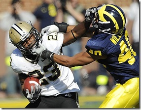(caption) Michigan safety Michael Williams (40) tackles Purdue Ralph Bolden in the first quarter. ***  The Michigan Wolverines host the Purdue Boilermakers in a must-win game. A Michigan victory would make them bowl eligible before their final two games at Wisconsin and home against Ohio State.  Photos taken on Saturday, November 7, 2009.   ( John T. Greilick / The Detroit News )