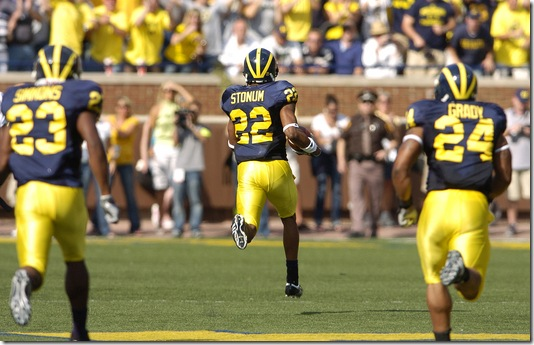 Michigan's Darryl Stonum leaves nothing but vapor trails behind him as heads 94-yards untouched into the endzone for a first quarter touchdown on a kickoff return against Notre Dame during the Wolverine's 38-34 win over the Fighting Irish, Saturday, September 12th at Michigan Stadium.