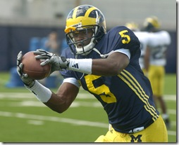 Michigan freshman safety Vladimir Emilien snares a pass during Thursday afternoon, August 20th's practice at the Michigan practice facility. 