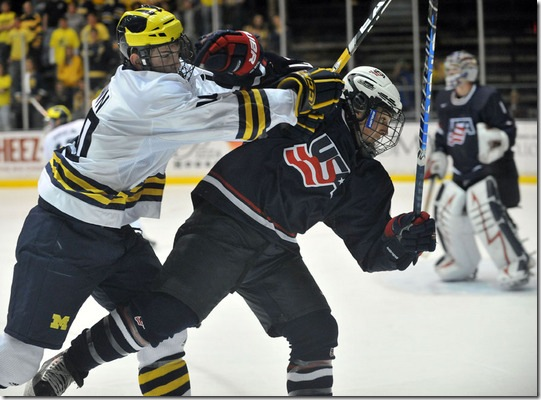 University of Michigan's Chris Brown checks U.S. National Under-18's Justin Faulk in the third period at Yost Arena on Oct 3, 2009.  U-M won the exhibition opener, 4-2.  (Mark Bialek for AnnArbor.com)