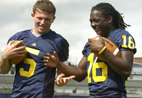 Michigan freshman quarterbacks Tate Forcier, left, and Denard Robinson clown around while posing for photographs during Sunday, August 23rd's Michigan Football Media Day outside the Al Glick Fieldhouse.<br /> Lon Horwedel | Ann Arbor.com