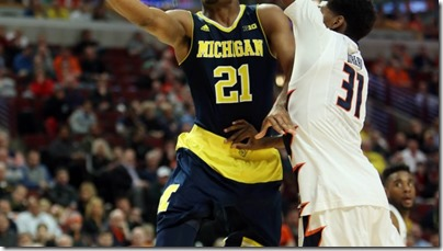 Mar 12, 2015; Chicago, IL, USA; Michigan Wolverines guard/forward Zak Irvin (21) shoots past Illinois Fighting Illini forward Austin Colbert (31) during the second half in the second round of the Big Ten Conference Tournament at United Center. Mandatory Credit: Jerry Lai-USA TODAY Sports