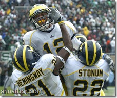 Michigan wide receiver Roy Roundtree leaps into the arms of his fellow receivers Junior Hemmingway, left, and Darryl Stonum after catching a touchdown pass from Tate Forcier in the back of the endzone with two seconds remaining in Saturday afternoon, October 3rd's clash with Michigan State. The ensuing extra point sent the game into overtime knotted 20-20. Unfortunately for Michigan, they turned the ball over on their first overtime possession, then had to watch Michigan State score a touchdown to win the game 26-20 in a classic duel at Spartan Stadium in East Lansing.Lon Horwedel | AnnArbor.com
