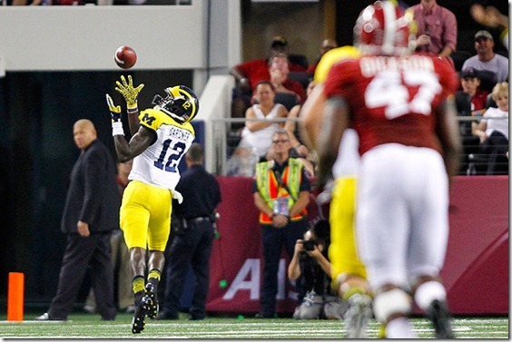 Sep 1, 2012; Arlington, TX, USA; MIchigan Wolverines  wide receiver Devin Gardner (12) catches a pass during the third quarter of the game against the Alabama Crimson Tide at Cowboys Stadium. Alabama beat Michigan 41-14. Mandatory Credit: Tim Heitman-US PRESSWIRE