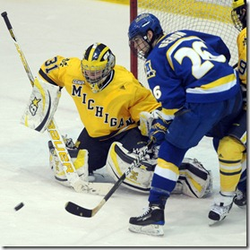 Michigan goalie Shawn Hunwick tries to keep Alaska Fairbank's Chad Gehon, right, from scoring during second period action of Saturday, Janaury 22nd's clash between the two teams at UM's Yost Ice Arena.Lon Horwedel | AnnArbor.com
