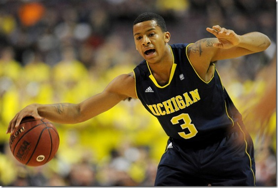 Michigan guard Trey Burke calls out to teammates on the court. Angela J. Cesere | AnnArbor.com