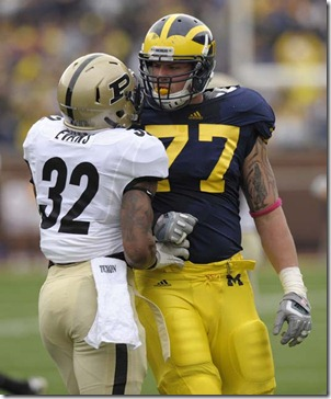 (CAPTION INFORMATION)Michigan offensive linesman Taylor Lewan and Purdue safety Albert Evans have words after a play.  Lewan was given a penalty for his troubles.               Photos are of the University of Michigan vs. Purdue University at Michigan Stadium in Ann Arbor, October 29, 2011.   (David Guralnick / The Detroit News)