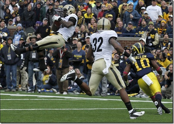 Purdue-s-Josh-Johnson-leaps-for-an-interception[1]