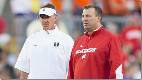 Sep 15, 2012; Madison, WI, USA;  Utah State Aggies head coach Gary Andersen (left) and Wisconsin Badgers head coach Bret Bielema (right) talk during warm-ups prior to their game at Camp Randall Stadium.  Mandatory Credit: Jeff Hanisch-USA TODAY Sports