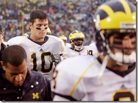 (caption) Michigan QBs Steven Threet (10) and Nick Sheridan (far right) walk off the field after the loss. *** Notre Dame takes advantage of six U-M turnovers to beat the Wolverines 35-17 at Notre Dame Stadium in South Bend, Indiana.  Photos taken on Saturday, September 13, 2008.  ( John T. Greilick / The Detroit News )