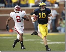 (caption) Michigan quarterback Steven Threet (10) outruns Wisconsin linebacker Jonathan Casillas for a 58-yard gain that set up the game winning touchdown late in the fourth quarter. Casillas caught Threet at the end of the run. *** Michigan rallies back from a 19-0 deficit to stun the ninth-ranked Wisconsin Badgers 27-25, giving new head coach Rich Rodriguez a victory in his first Big Ten game. *** The Michigan Wolverines (1-2) host the 9th-ranked Wisconsin Badgers in U-M head coach Rich Rodriguez' first Big Ten game. Photos taken on Saturday, September 27, 2008.  ( John T. Greilick / The Detroit News )