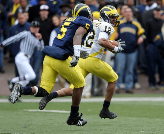 Michigan receiver Roy Roundtree, right, looks back at teammate Vladimir Emilien before leaving him in his wake en route to a 97-yard touchdown reception from quarterback Denard Robinson during the Wolverine's annual spring game, Saturday, April 17th at Michigan Stadium.Lon Horwedel | AnnArbor.com