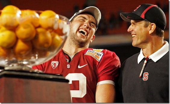 Jan 3, 2011; Miami, FL, USA; Stanford Cardinal quarterback Andrew Luck (12) and head coach Jim Harbaugh celebrate after defeating the Virginia Tech Hokies 40-12 in the 2011 Orange Bowl at Sun Life Stadium. Mandatory Credit: Douglas Jones-USA TODAY Sports