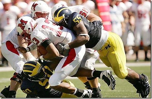 (caption) Michigan defensive end Brandon Graham (55) sacks Miami (OH) quarterback Clay Belton (13) late in the fourth quarter. Also applying pressure on the play is Michigan defensive end Tim Jamison (90). *** Michigan head coach Rich Rodriguez gets he first victory 16-6 over Miami of Ohio, the school that produced legendary Michigan coach Bo Schembechler. at Michigan Stadium in Ann Arbor.  Photos taken on Saturday, September 6, 2008.  ( John T. Greilick / The Detroit News )