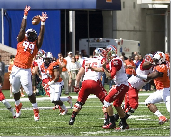 Sep 6, 2014; Champaign, IL, USA; Illinois Fighting Illini defensive lineman Jarrod Clements (99) blocks a pass in the game between the Illinois Fighting Illini and the Western Kentucky Hilltoppers at Memorial Stadium.  Illinois beat Western Kentucky 42-34. Mandatory Credit: Mike Granse-USA TODAY Sports