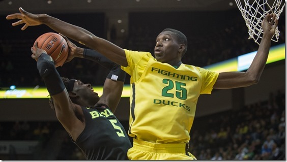 Oregon Ducks forward Chris Boucher (25) jumps to block the shot of Baylor Bears forward Johnathan Motley (5). The No. 25 Oregon Ducks take on the No. 20 Baylor Bears at Matthew Knight Arena on Nov. 11, 2015. (Adam Eberhardt/Emerald)