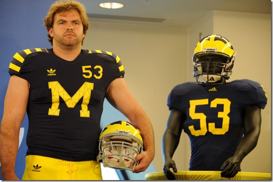 Michigan football defensive end Ryan Van Bergen models the retro jersey to be worn for the Michigan vs. Notre Dame