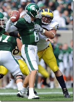 Michigan's Ryan Van Bergen, #53, hauls down Michigan State University quarterback Kirk Cousins during secind quarter action of Saturday afternoon, October 3rd's clash between the in-state rivals at Spartan Stadium in East Lansing. 
