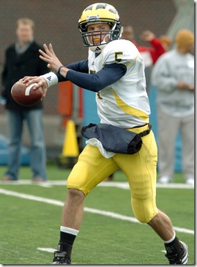 LON HORWEDEL,THE ANN ARBOR NEWS Incoming freshman Michigan quarterback Tate Forcier throws on the run while doing quarterback passing drills during Saturday, March 21st's practice at UM's practice field outside of Schembechler Hall.